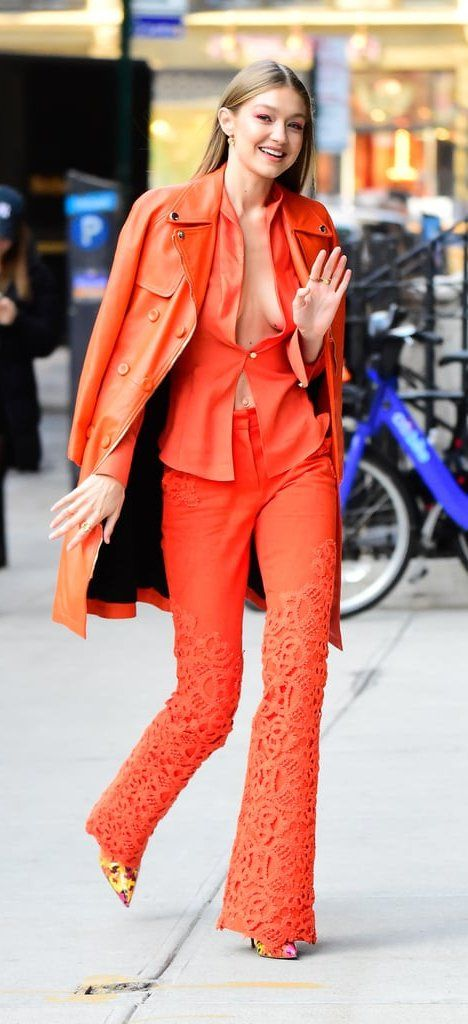 Gigi Hadid orange monochrome suit street style 2018 - 1