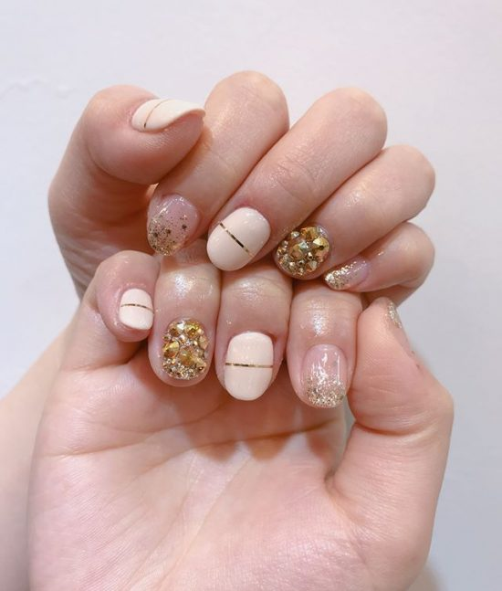 2 Nude Nails With Bling and Glitter